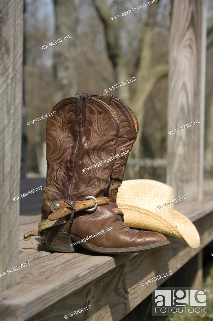 Stock Photo: Cowboy boots and hat.