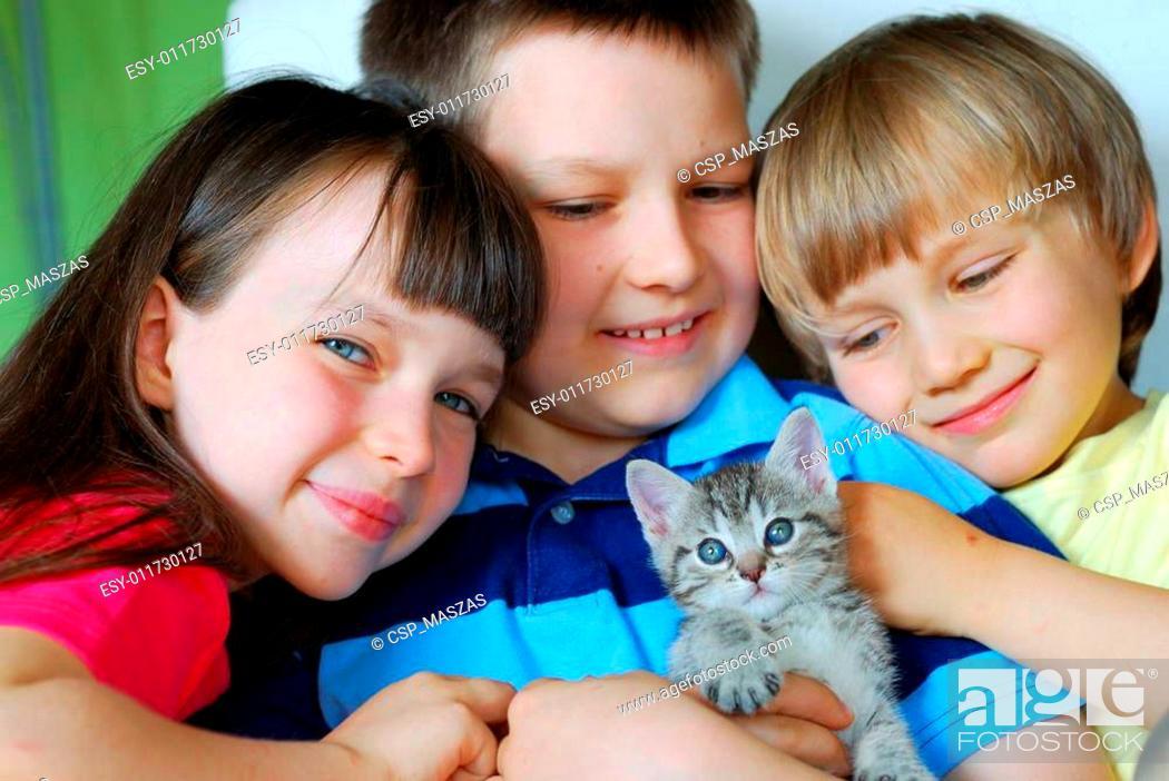Stock Photo: Children with kitten.