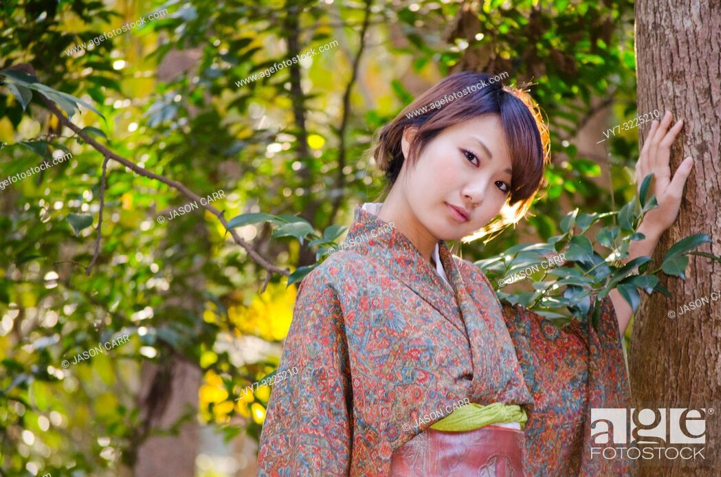Stock Photo: Japanese Girl poses on the street in Kamakura, Japan. Kamakura is an area located in Kanagawa where is a bit south of Tokyo.