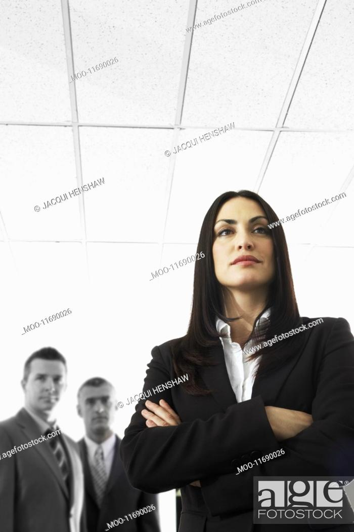 Stock Photo: Businesswoman with Businessmen in Background.
