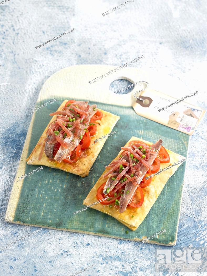 Stock Photo: coca crujiente anchoas / crispy coca anchovies.
