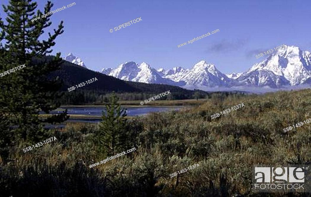 Stock Photo: Panoramic view of snow covered mountains, Teton Range, Grand Teton National Park, Wyoming, USA.