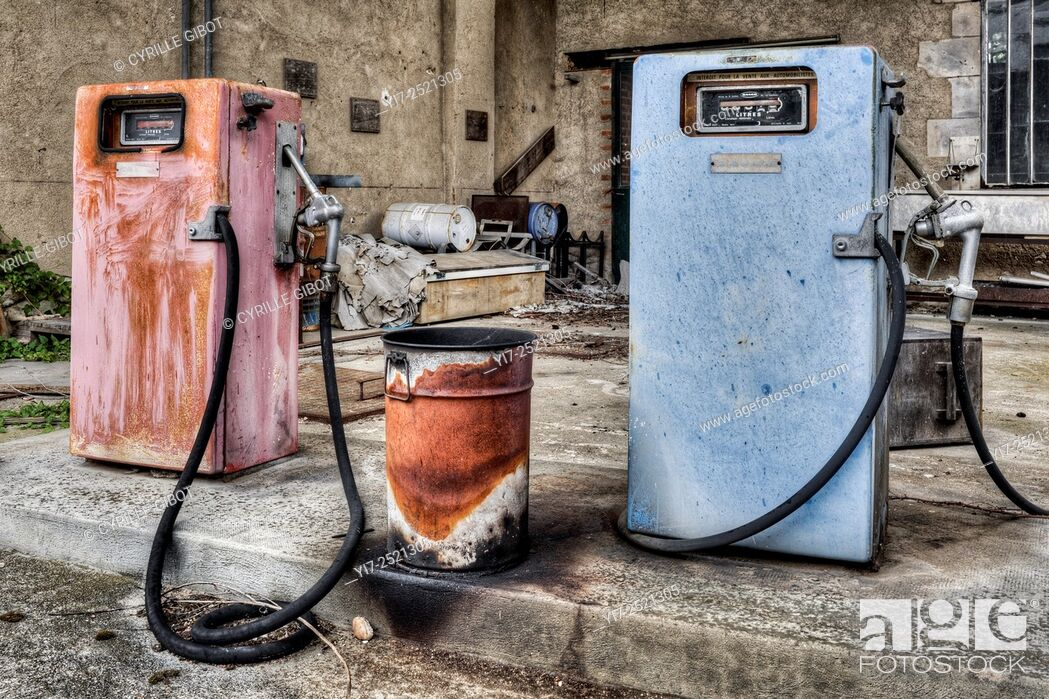 Stock Photo: Abandoned gas pumps and station.
