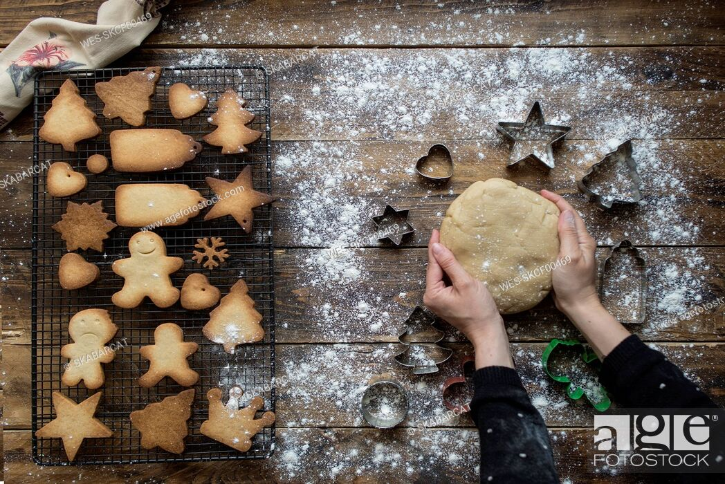 Stock Photo: Woman's hands kneading dough for gingerbread cookies.