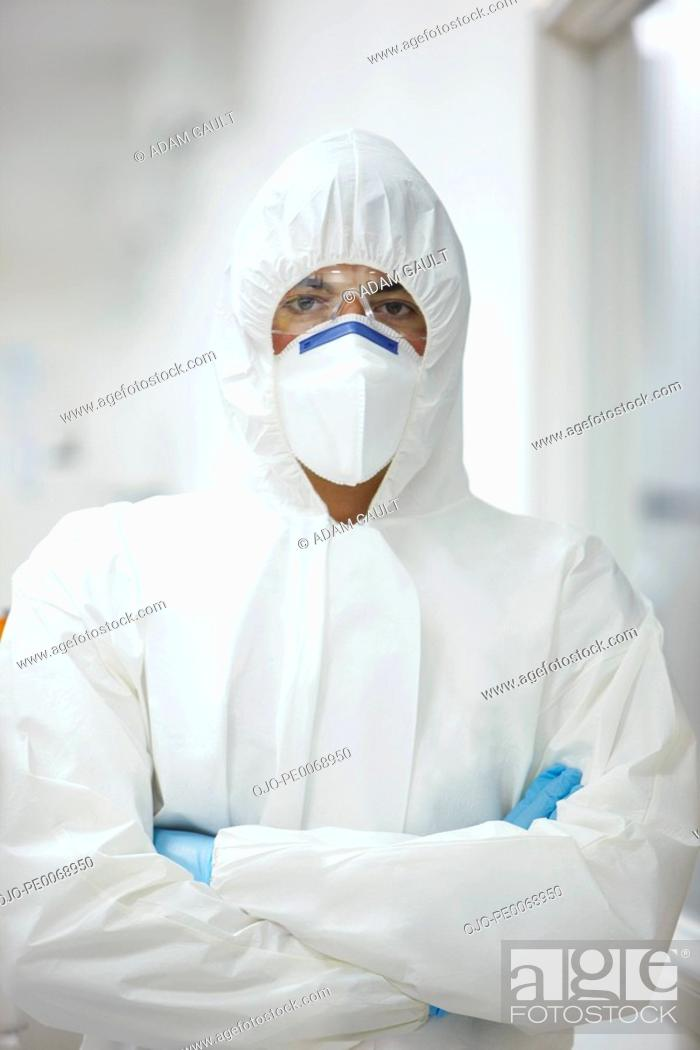 Stock Photo: Scientist in protective clothing with arms crossed.
