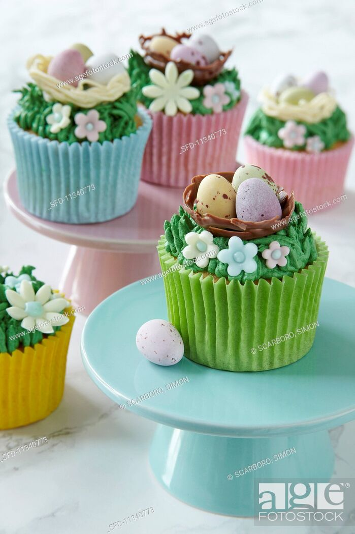 Stock Photo: Easter cupcakes topped with cream and sugar decorations.