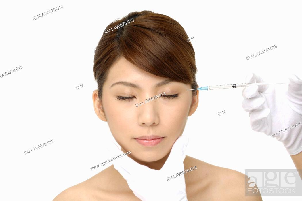 Stock Photo: cosmetic treatment with botox injection.