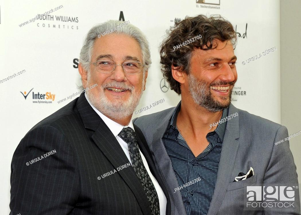 Tenor singers Placido Domingo (L) and Jonas Kaufmann arrive for the