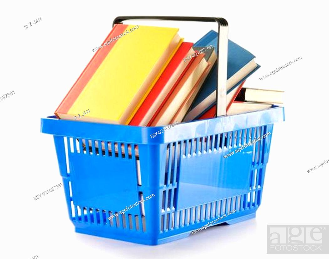Imagen: Plastic shopping basket with books isolated on white.