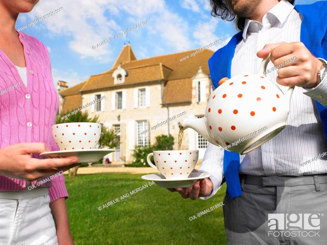 Stock Photo: Drinking tea in front of country home.