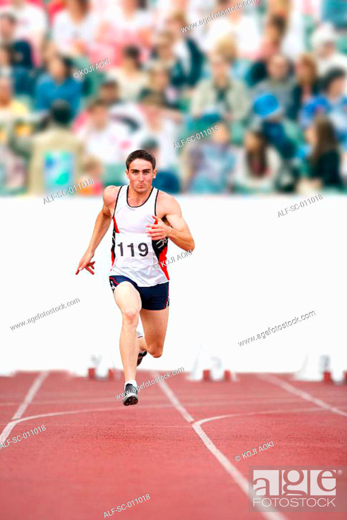 Stock Photo: Male Runner Sprinting Down a Track.
