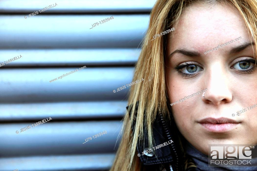 Stock Photo: Portrait of young woman looking at camera.