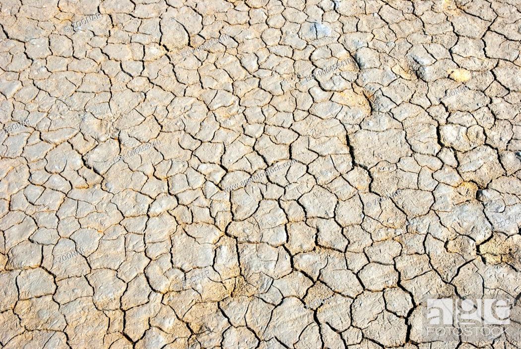 Stock Photo: Dry cracked land.