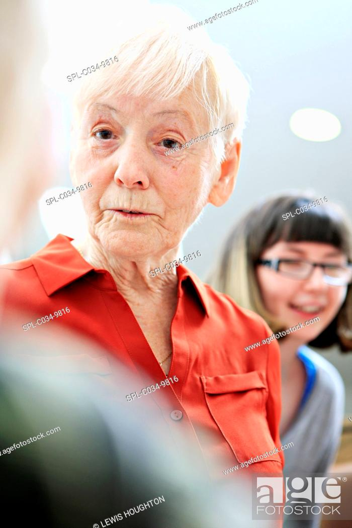 Stock Photo: MODEL RELEASED. Woman with dementia with social care worker. Dementia is a general term for conditions that lead to changes in a person's ability to think.