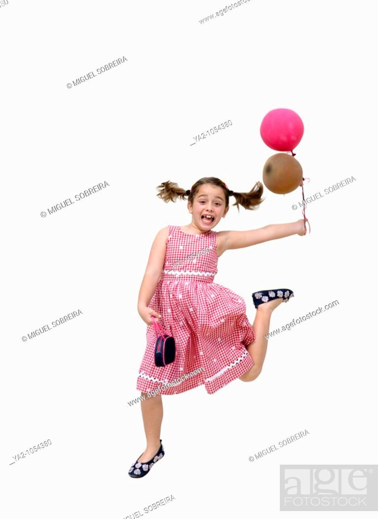 Stock Photo: Girl jumping up in the air with purse and balloons - about to go to party.