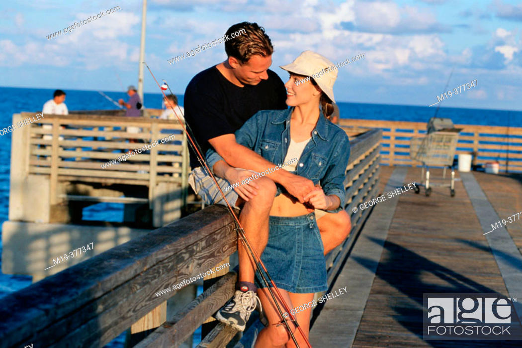 Stock Photo: couple on a fishing pier.