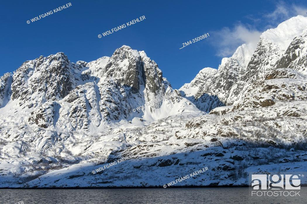 Stock Photo: View of fjords with snow covered mountains near Svolvaer, a fishing town in the Lofoten Islands, Nordland County, Norway.