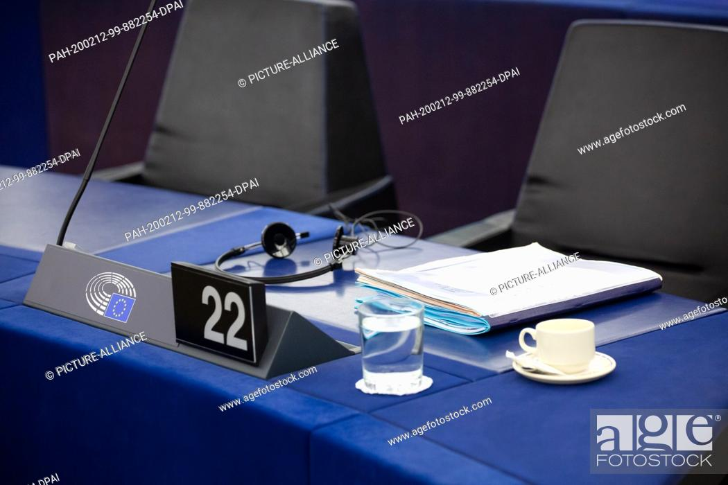 Stock Photo: 11 February 2020, France, Straßburg: Files, a glass of water and coffee lie and stand on the table of M. Barnier, head of the EU Task Force for negotiations.