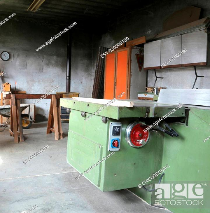 Stock Photo: old big machine to cut the wooden planks in an abandoned carpentry.