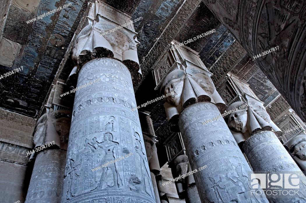 Stock Photo: Dendera Egypt, temple dedicated to the goddess Hathor. View of ceiling and columns in the hypostyle hall before cleaning.