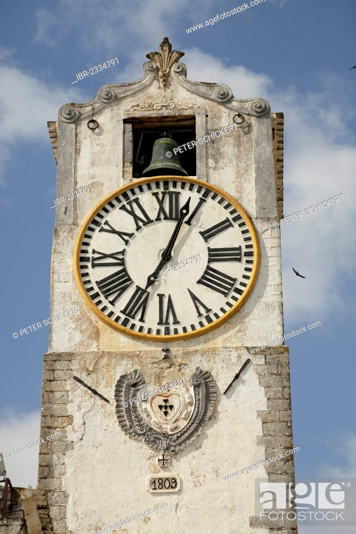 Stock Photo: Bell tower with clock of the Santa Mario do Castelo church in the old town of Tavira, Algarve, Portugal, Europe.