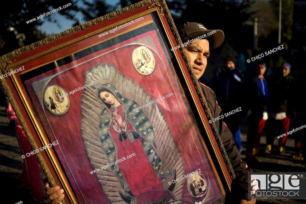 Stock Photo: A pilgrim carries an image of the Our Lady of Guadalupe in Mexico City, December 10, 2010  Hundreds of thousands of Mexican pilgrims converged on the Our Lady.