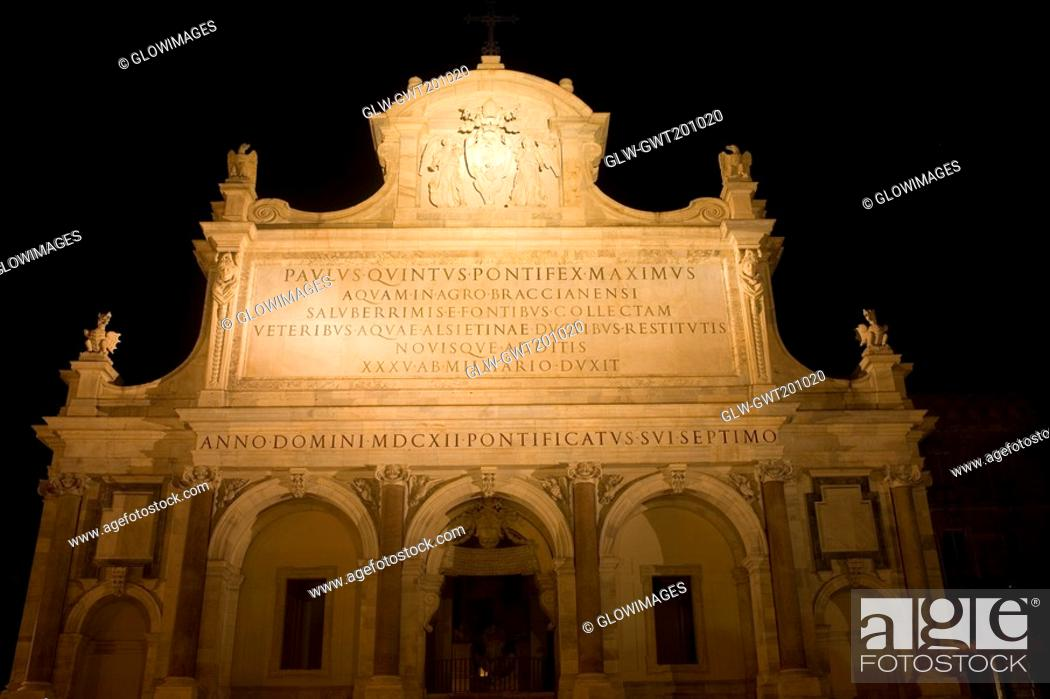 Stock Photo: Low angle view of a church lit up at night, Fontana dell'Acqua Paola, Rome, Italy.