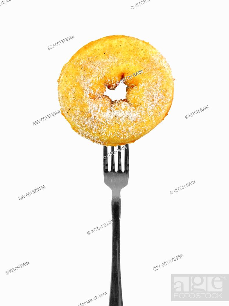 Stock Photo: Conceptual diet image with food on a fork.