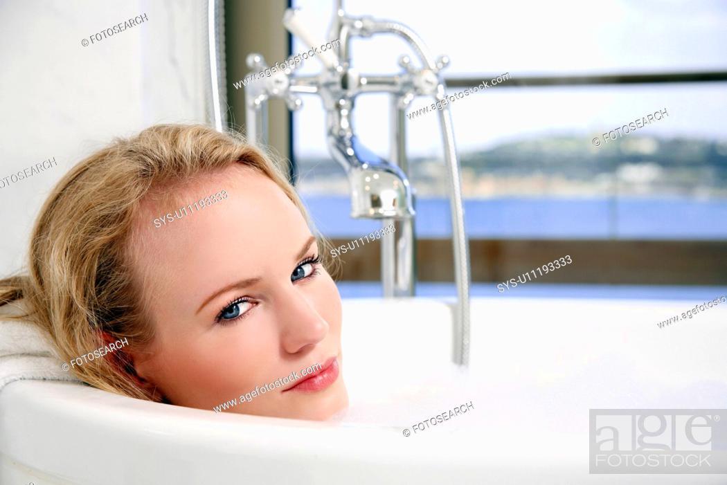 Stock Photo: Woman enjoying bubble bath.