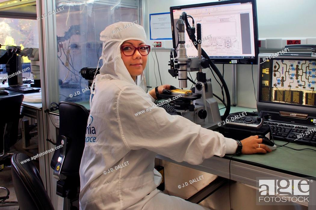 Stock Photo: Technician Sandra Brunet working on hybrid, manufacture of microelectronic hybrids, Thales Aleniaspace, Toulouse, Haute-Garonne, Midi-Pyrenees, France.