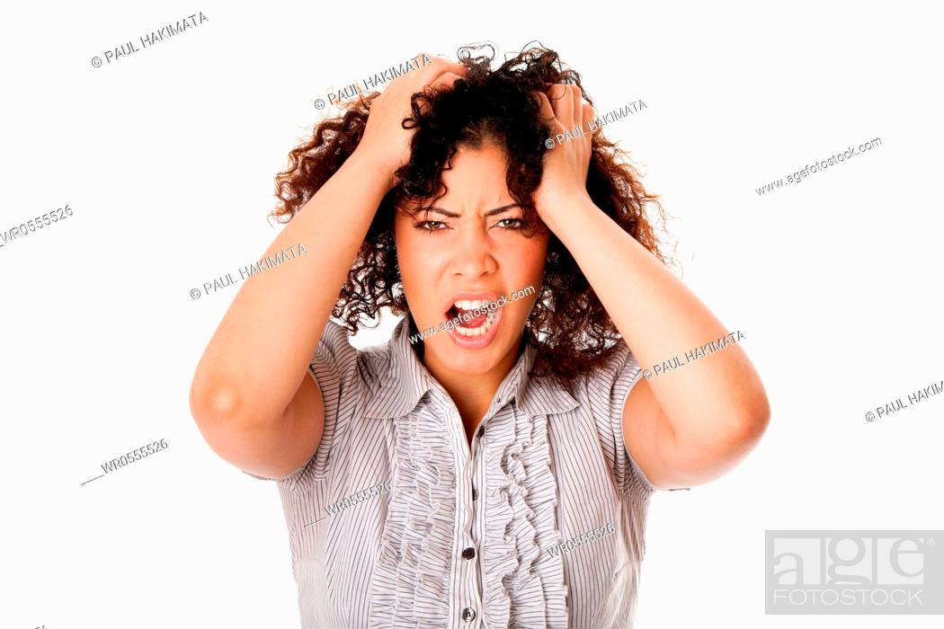 Imagen: Frustrated angry formal corporate business woman with curly hairwith hands in hair and screaming yelling, isolated.