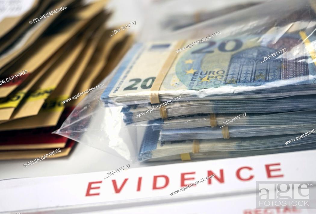 Stock Photo: dollar bills in criminal investigation unit, conceptual image.