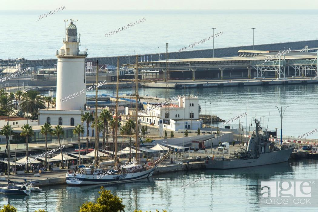 Stock Photo: Lighthouse and harbour in Malaga, Spain.