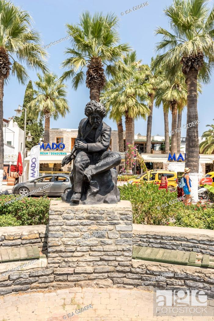 Stock Photo: View of musician statue at Bodrum streets with hotel and motels on background, Turkey. 23 August 2017.