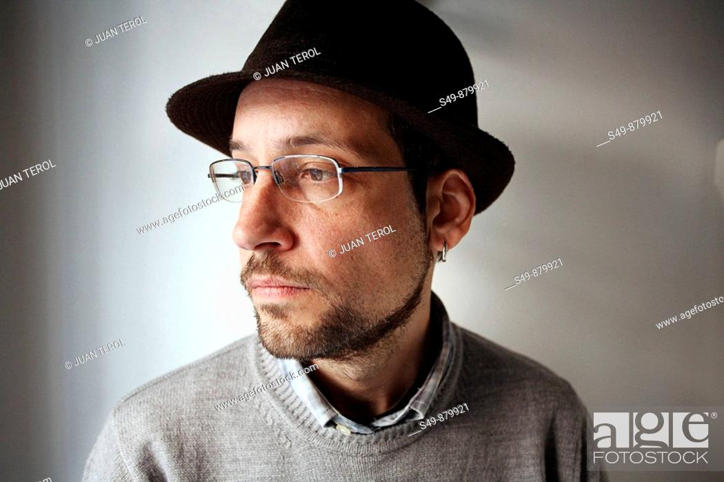 Stock Photo: Man wearing glasses and hat.