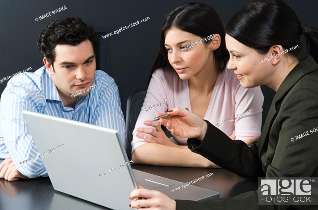 Stock Photo: Bank manager helping couple.