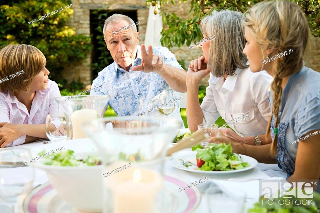 Stock Photo: Family eating lunch outdoors.