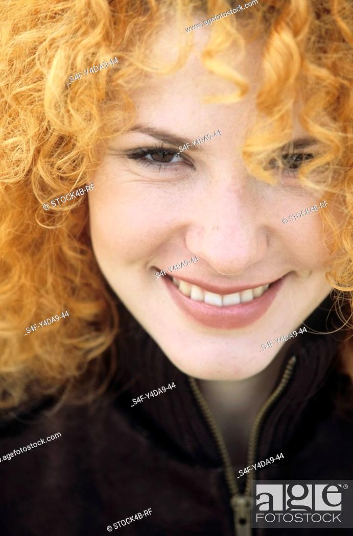 Stock Photo: Portrait of a young Woman with strawberry-blonde Curls - Hair.