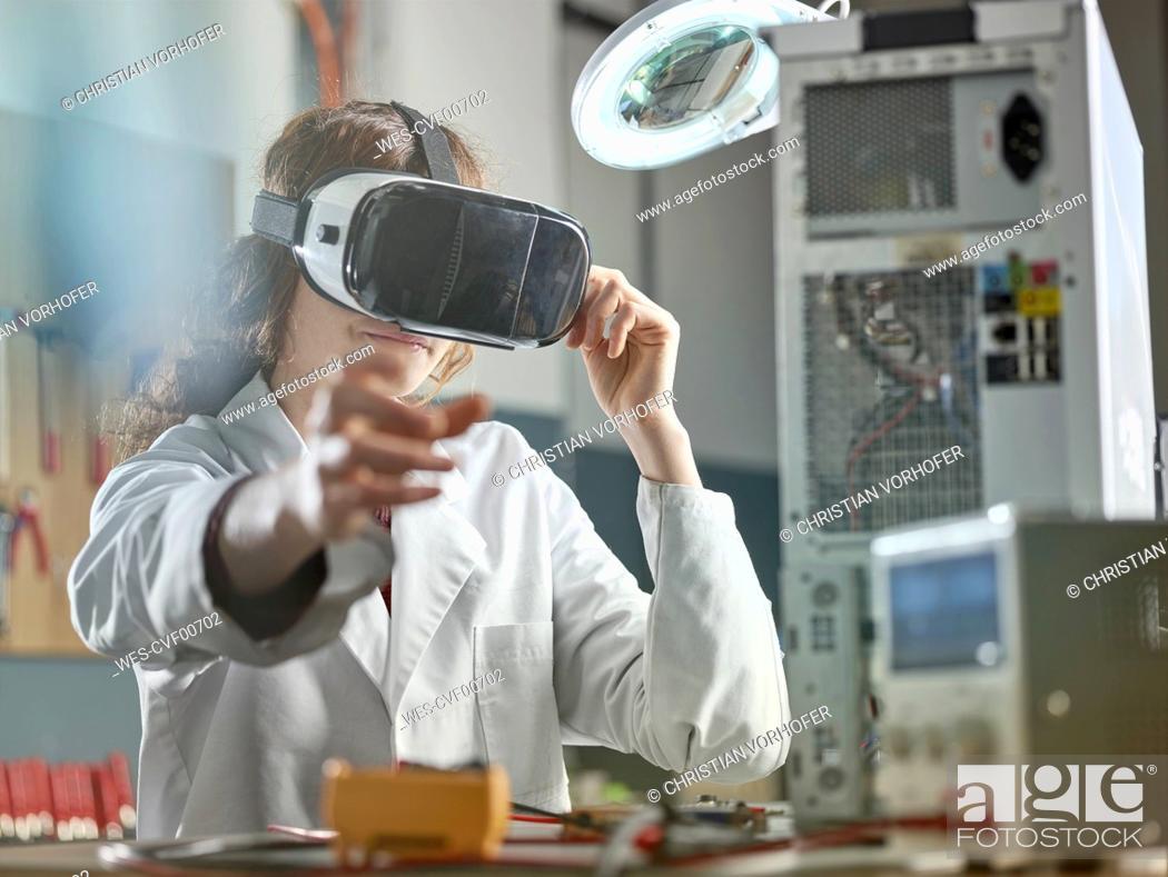 Stock Photo: female engineer using virtual reality headset.