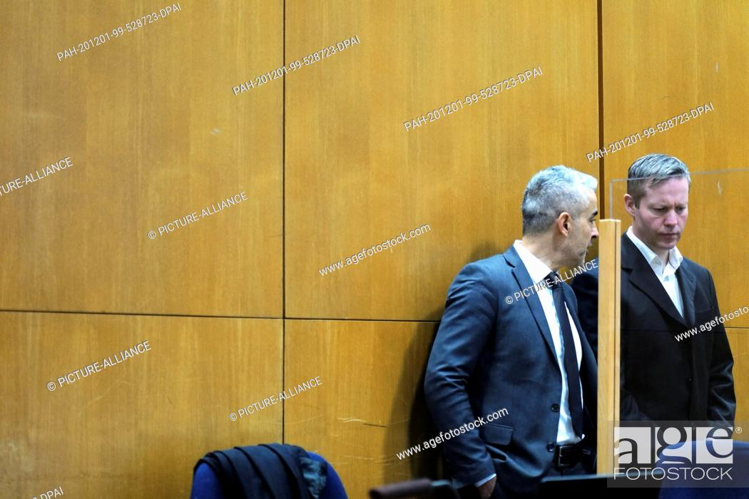 Stock Photo: 01 December 2020, Frankfurt/Main: The main defendant Stephan Ernst (r) and his lawyer Mustafa Kaplan are waiting in the courtroom of the Higher Regional Court.
