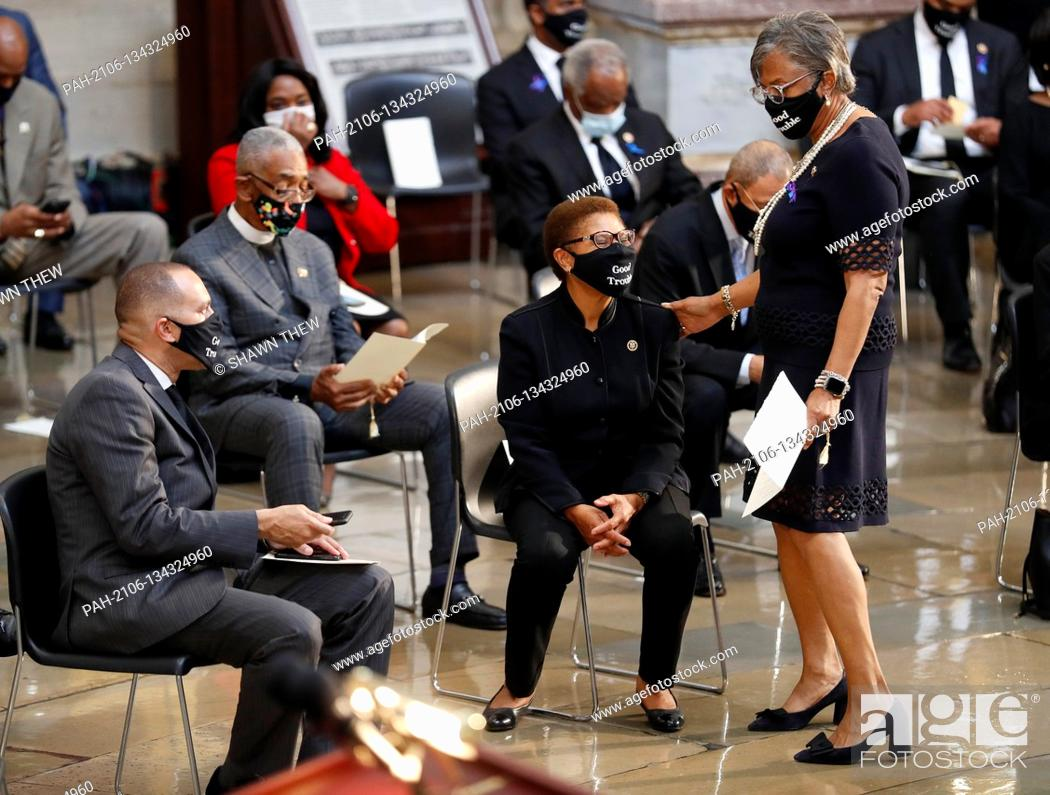Stock Photo: Chair of the Congressional Black Caucus, United States Representative Karen Bass (Democrat of California) (seated, C) prior to the start of the ceremony.