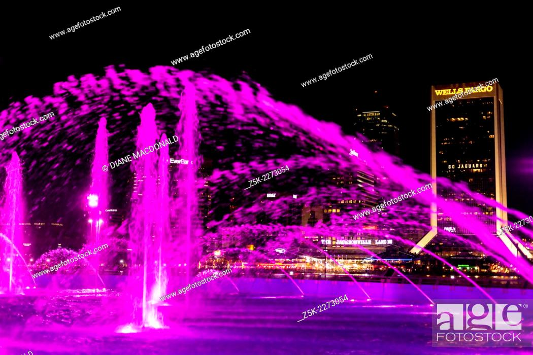 Stock Photo: Friendship Fountain, Jacksonville, Florida, USA at night. Across the river can be seen downtown Jacksonville and the Jacksonville Landing.