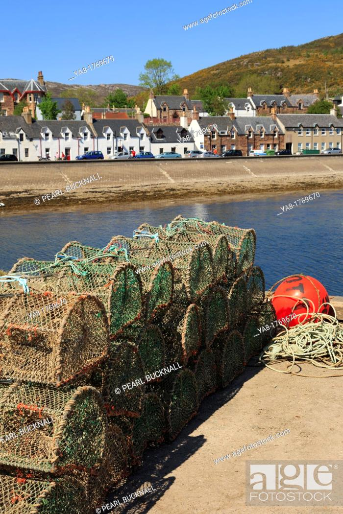 Stock Photo: Ullapool, Ross and Cromarty, Highland, Scotland, UK, Britain, Europe  Lobster pots on the quayside in fishing harbour on Loch Broom on north west highlands.