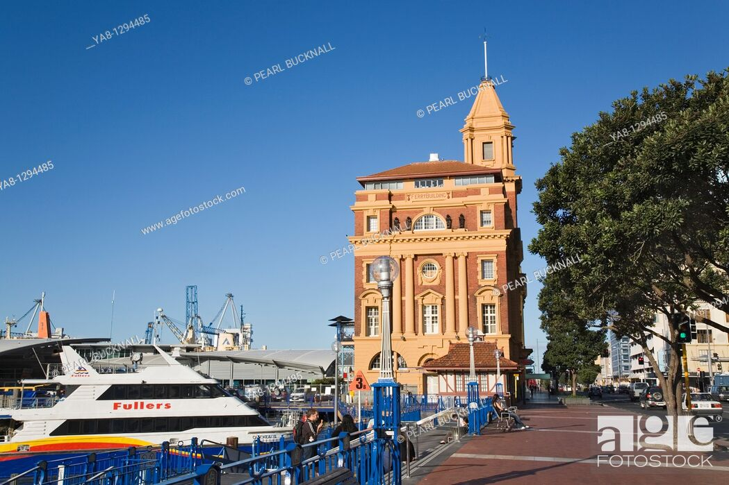 Stock Photo: Auckland, North Island, New Zealand  Neoclassical Ferry Building 1912 for port on waterfront with Fullers Quickcat Ferry by Queen's Wharf in Waitemata Harbour.