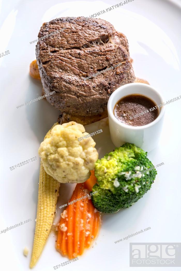 Stock Photo: Grilled beef steak tenderloin with vegetable.