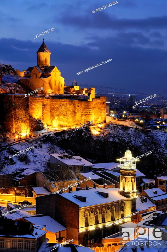 Stock Photo: The old town with the mosque, the Narikala fortress and St Nicholas church in a winter evening. Georgia, Caucasus, Tbilisi.