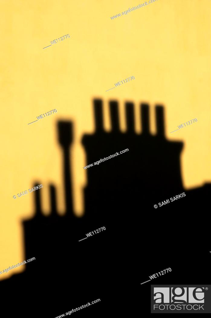 Stock Photo: Chimneys silhouetted against the evening sky, Marseille, France.