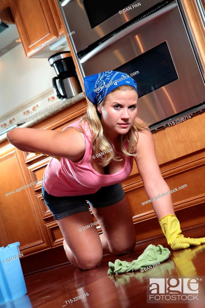 Stock Photo: A young woman hurt mopping floor.