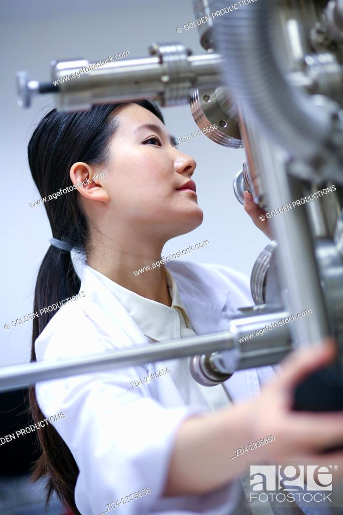 Stock Photo: Researcher. Surface spectrometer, Photoelectron spectroscopy, Auger Electron Spectroscopy, AES, VG Scientific ESCAlab 200D Surface Analysis Equipment.