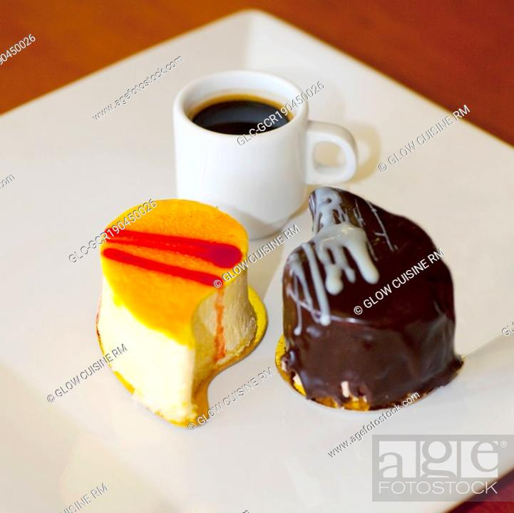 Stock Photo: Close-up of assorted pastries with a cup of black coffee.